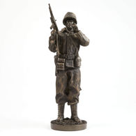 cold-cast resin WWII Sergeant Statue has antique bronze finish and is poised in full contemplation, with stogie in hand.