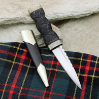 Windlass Sgian Dubh has sharp high carbon steel blade, black wood handle and embossed nickel silver fittings with thistle motif