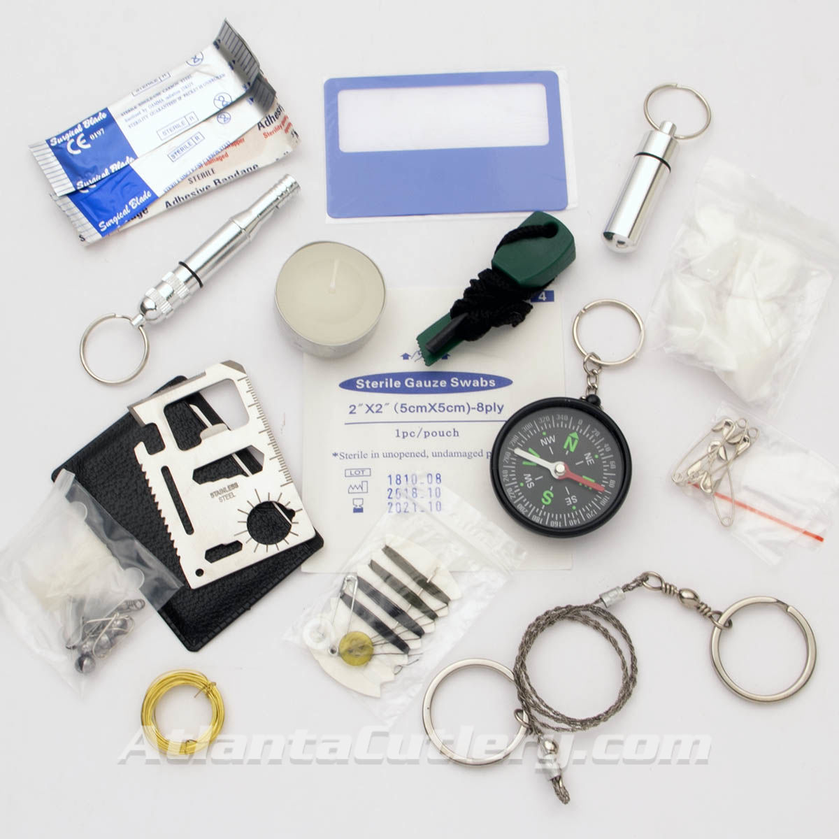 "Survival Kit holds emergency essentials: first aid supplies, fishing line, wire saw, compass, multi-tool ""card"", fire starter and more"