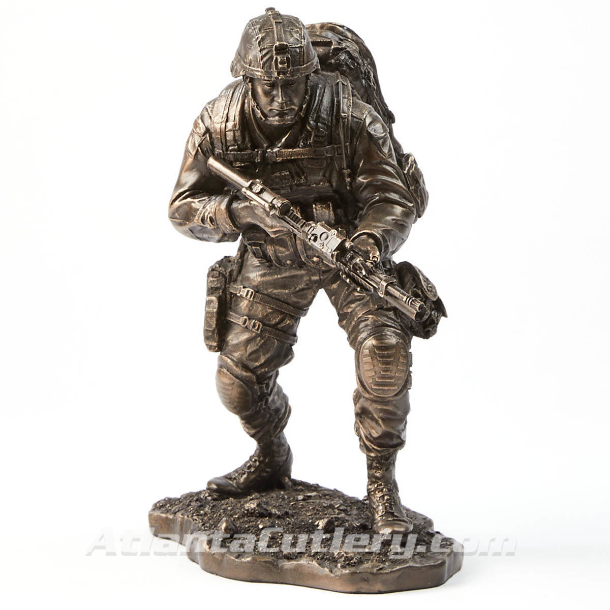 Cold-cast resin modern soldier statue has an antique bronze finish with accurately sculpted clothing, gear, and weapons