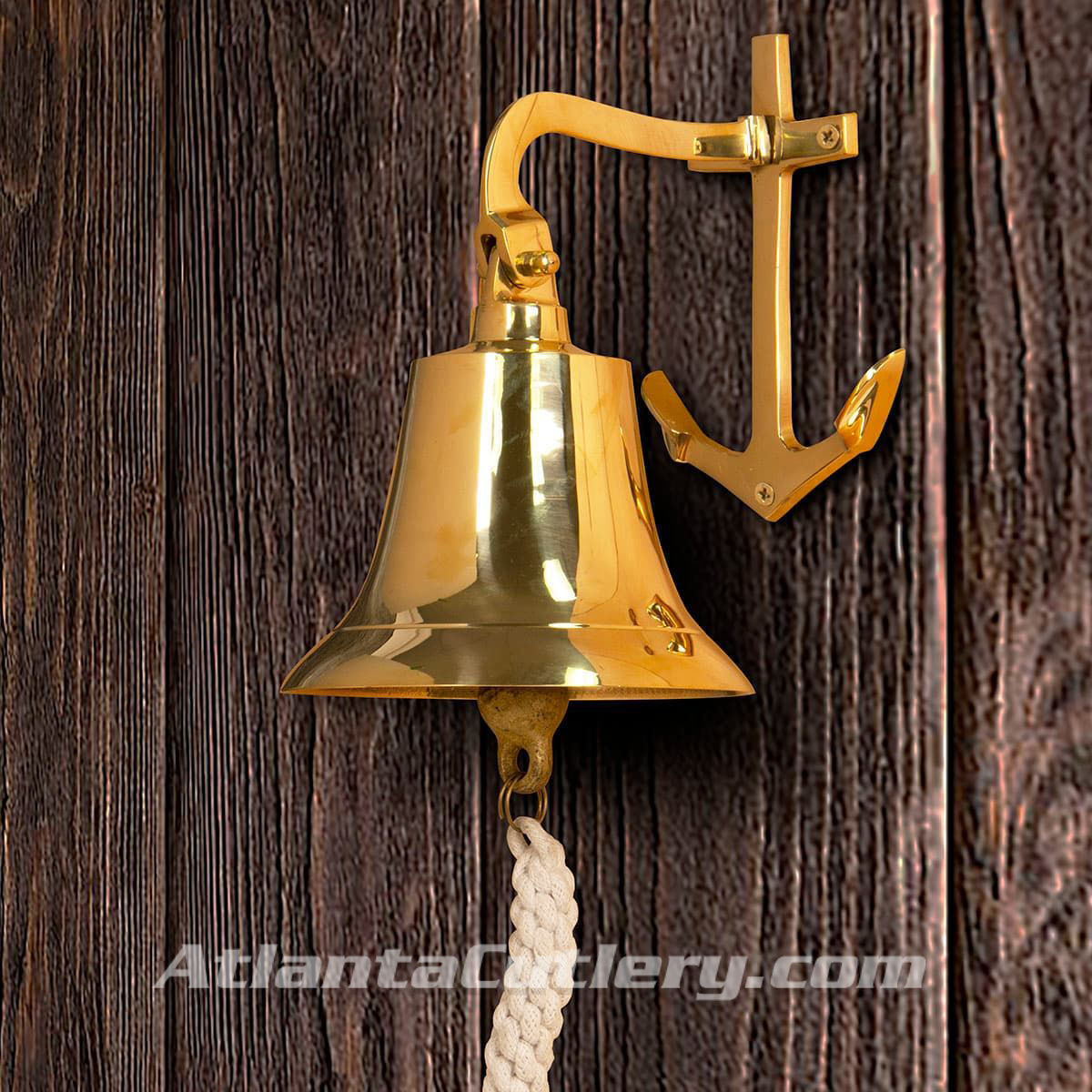 polished solid brass bell with anchor-shaped wall mount bracket and rich clear tone