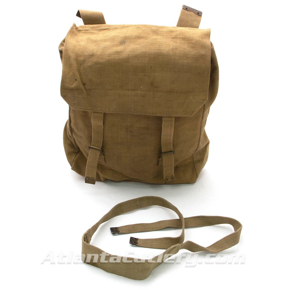 issued condition British military surplus canvas backpack has shoulder strap and attachments to connect to soldier's webbing