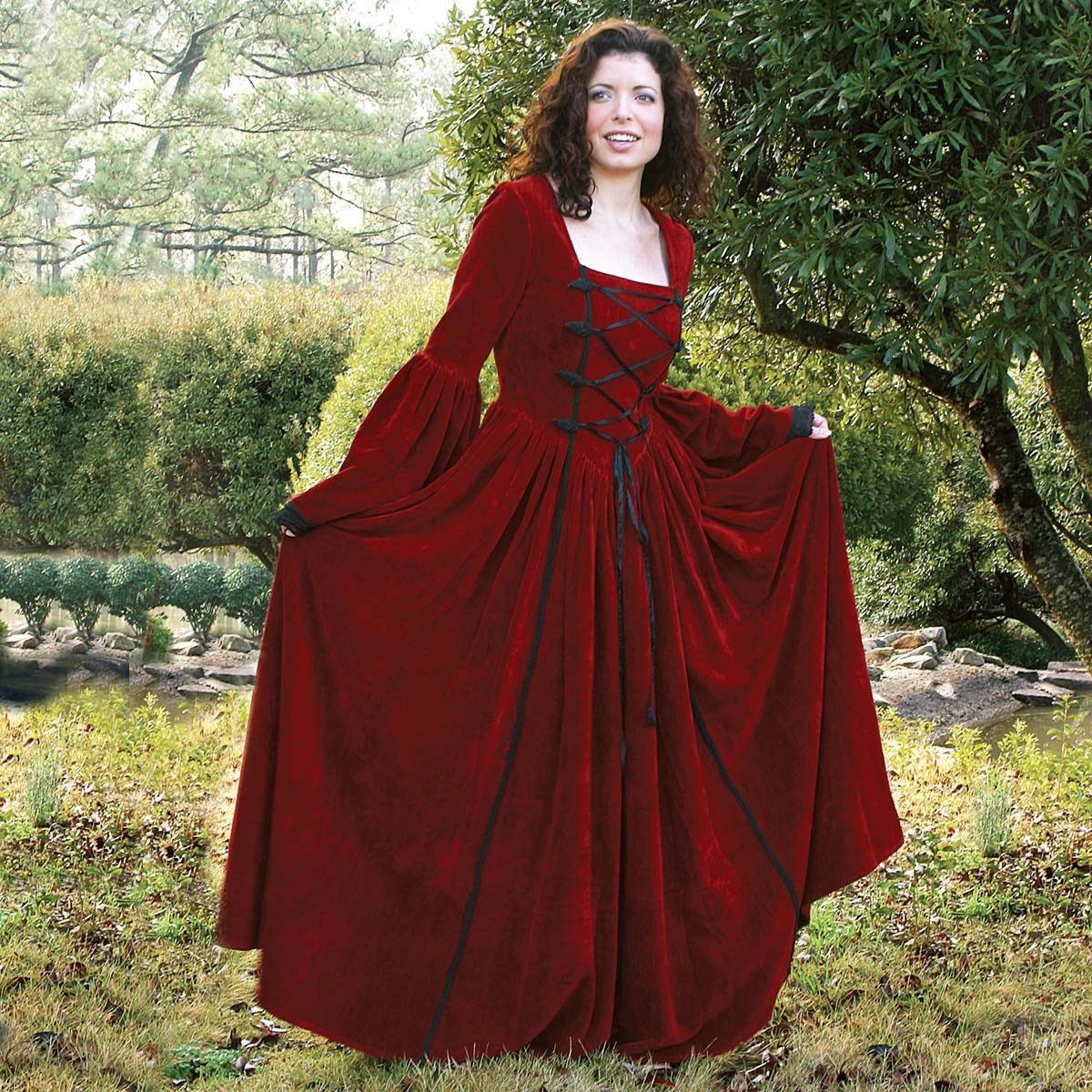 This red 100% cotton velvet medieval dress has full bell sleeves and a full skirt. Matching handmade frogs compliment the black lace-up bodice