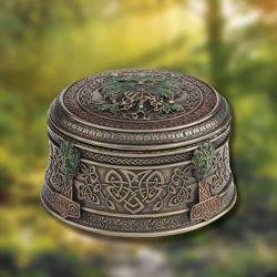 Trinket box with Green Man imagery on the lid and the sides has a soft, antique greenwash