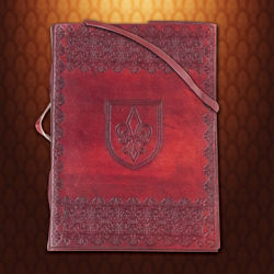 Leather journal embossed with a shield and the Fleur de Lis of France on front and back, closes with a long leather cord.
