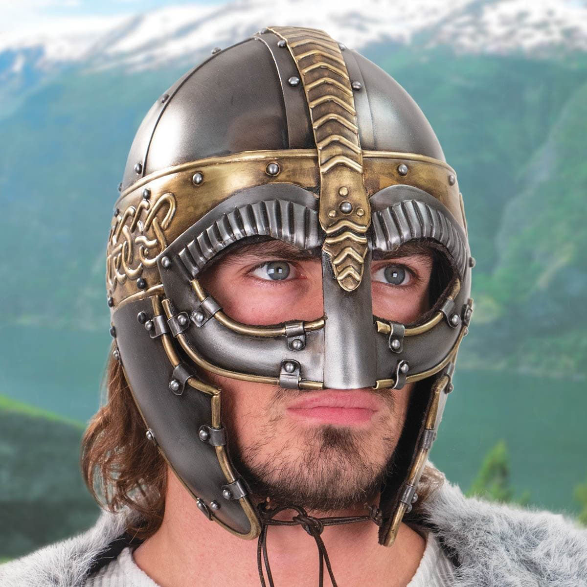 Norseman helmet by Windlass Steelcrafts is the Gjermundbu type and made of 18 gauge steel and brass. Features opulent details.