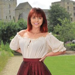 Renaissance Faire blouse in natural worn off the shoulder