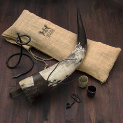 Oversized Drinking Horn includes stand, Bottle Opener, holster, jute carry bag, shot glasses and iron bottle opener