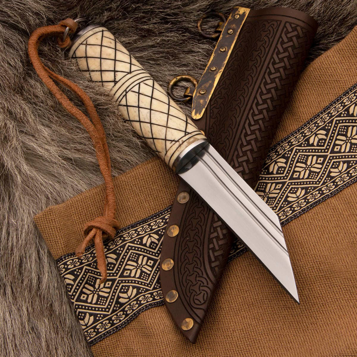 Voyager Scramasax Viking Knife with high carbon steel blade, brass hardware, carved bone handle and embossed leather sheath