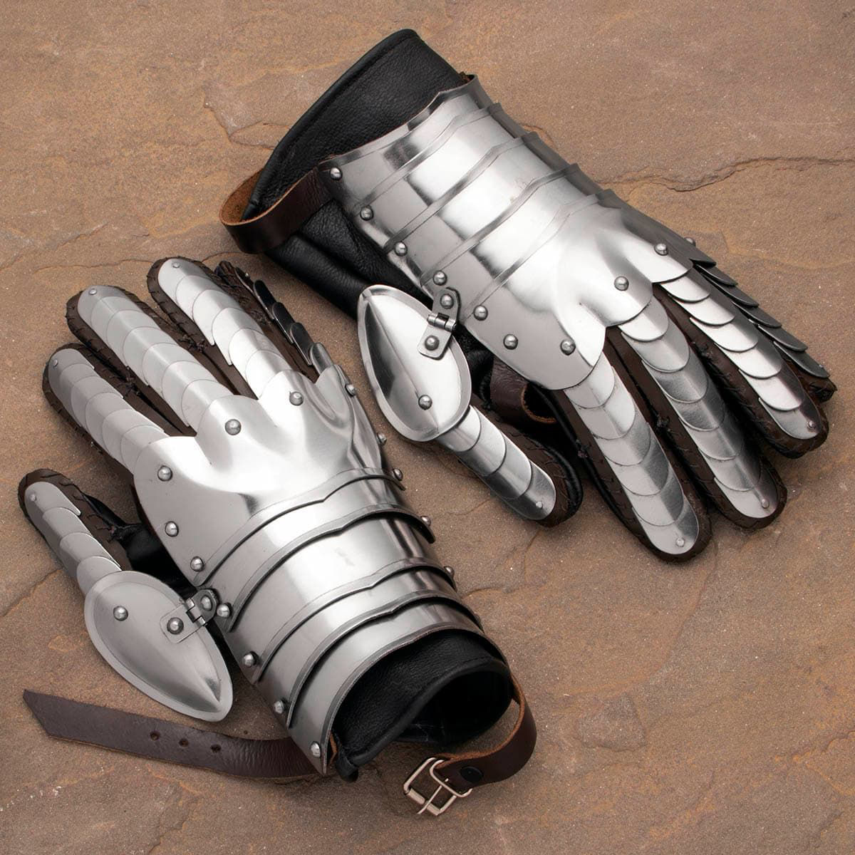 Wearable Articulated Scale Gauntlets crafted from plates of riveted 18 gauge steel with an integrated suede leather glove
