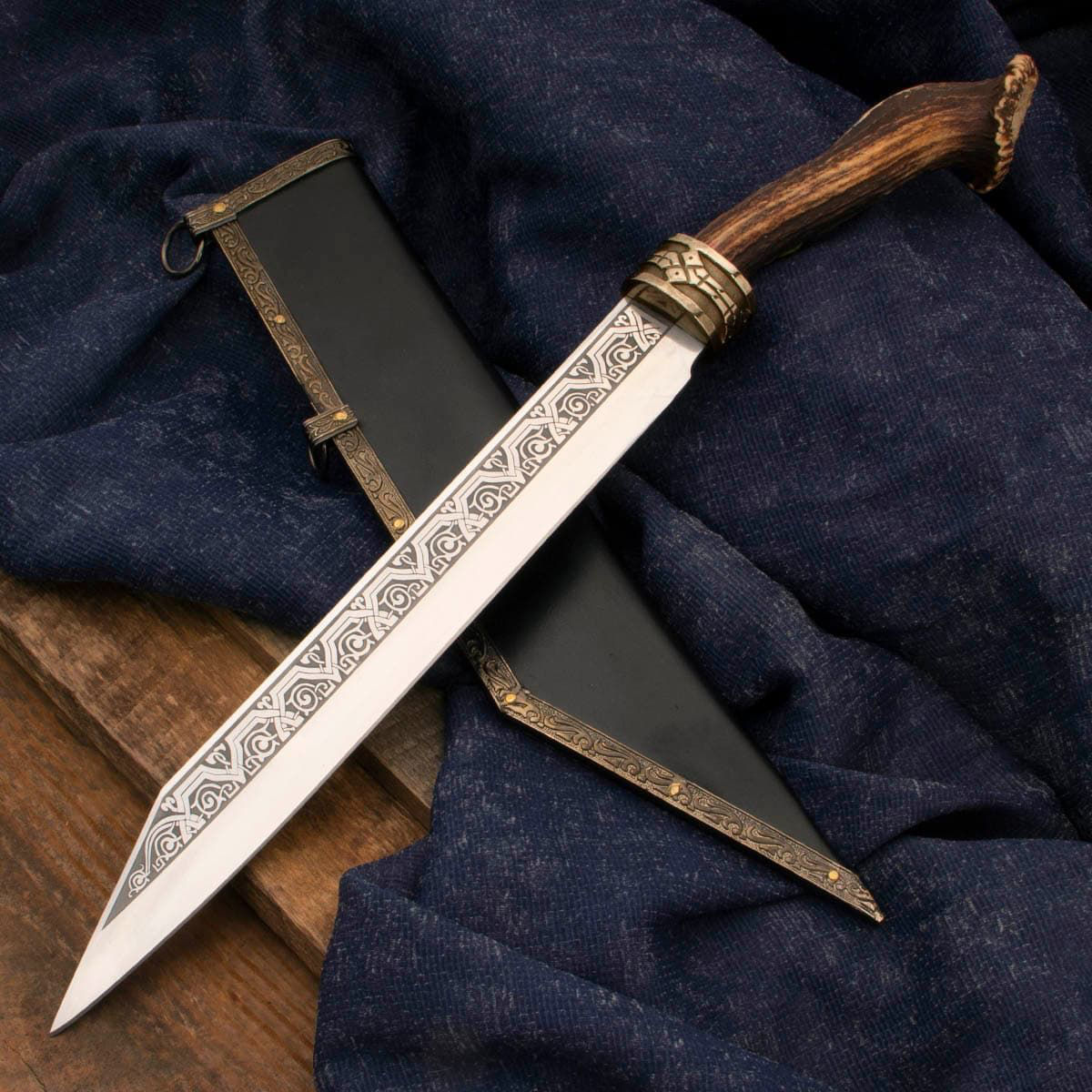 Royal Stag Seax has engraved, sharpened high carbon steel blade, brass guard with Nordic relief and Sambar Stag handle