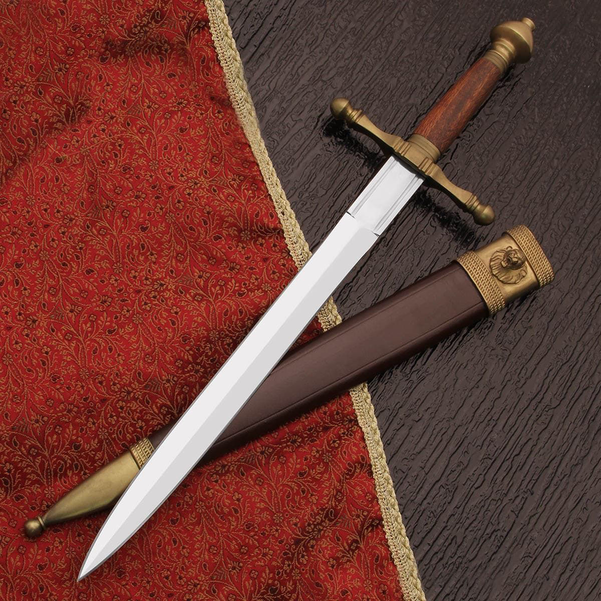 Bramham Moor Medieval Dagger by Windlass has high carbon steel blade, matte brass fittings and leather scabbard with lion's head