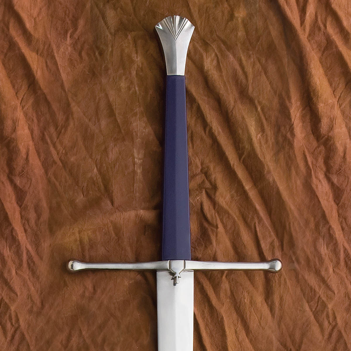 This sword is balanced for two-handed use, allowing for sweeping cuts. Wood grip is covered in leather, parts are steel