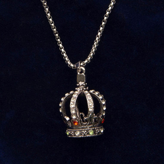 Necklace has heavy chain and mini crown pendant bejeweled with faux rubies, diamonds, and emeralds