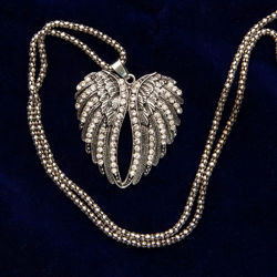 angel wings pendant has sparkling faux diamonds and hangs from a long, heavy silver finish chain