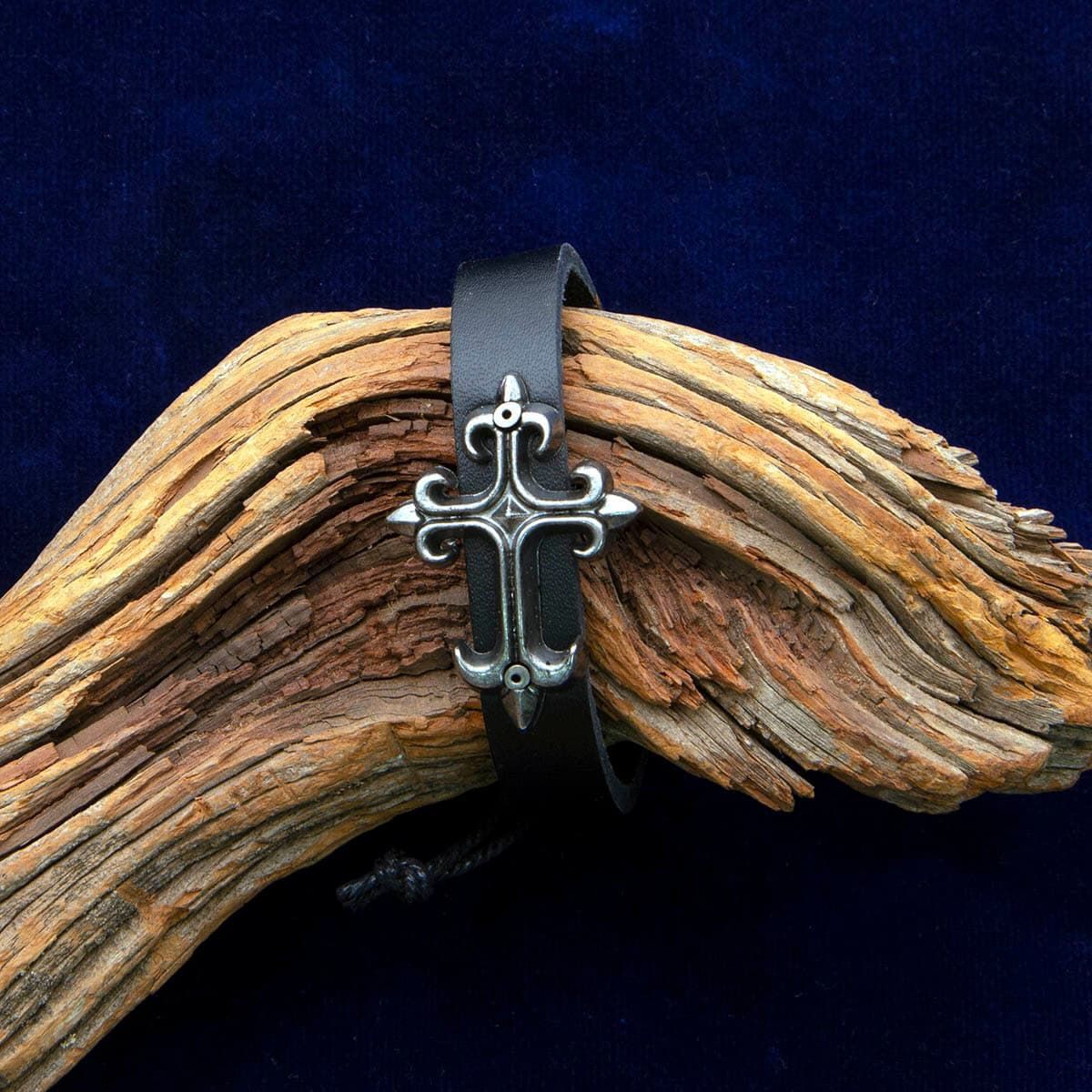 Comfortable leather cuff bracelet with adjustable cord and silver metal cross