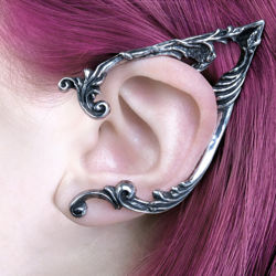 polished, antiqued pewter pointed elf ear-shaped ear wrap with floral scrollwork frames the left ear and fastens at the lobe