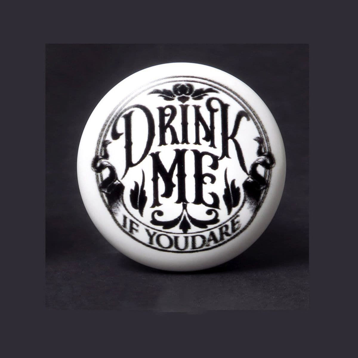 Drink Me If You Dare cork stopper with ceramic top inviting you to partake, if you dare