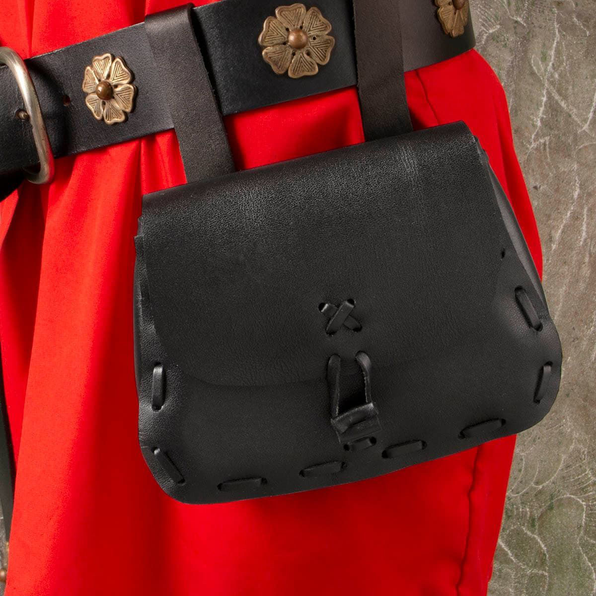 black leather pouch with leather toggle closure shown on belt